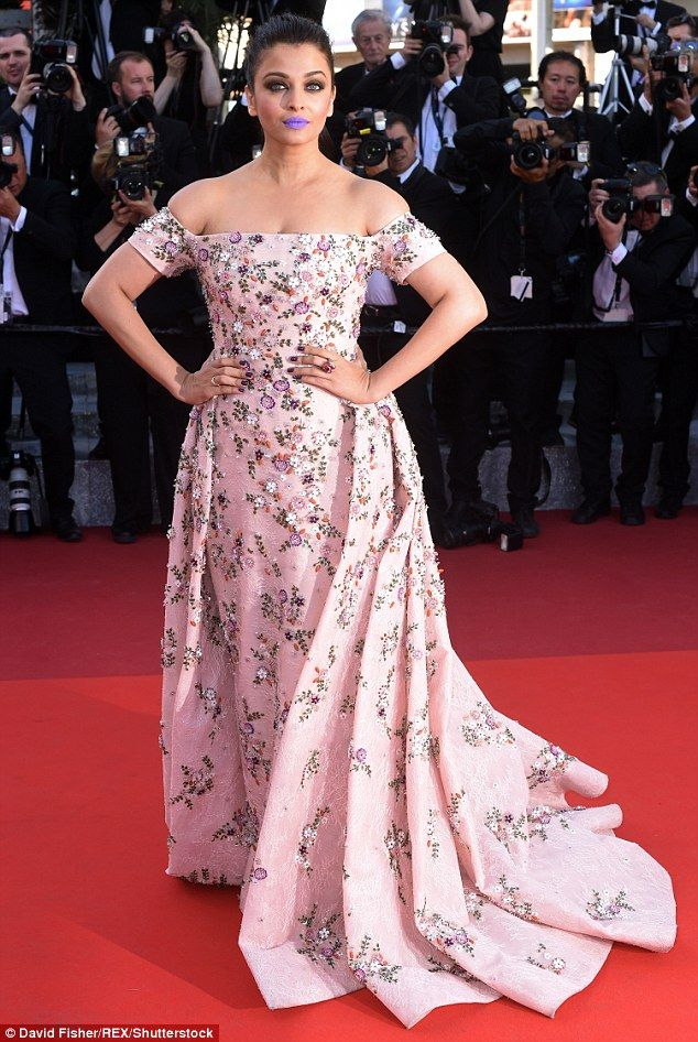 Pretty in purple! Aishwarya Rai Bachchan pushed her fashion credentials to the limit as she sported a bold lilac lipstick at the Cannes Film Festival on Sunday