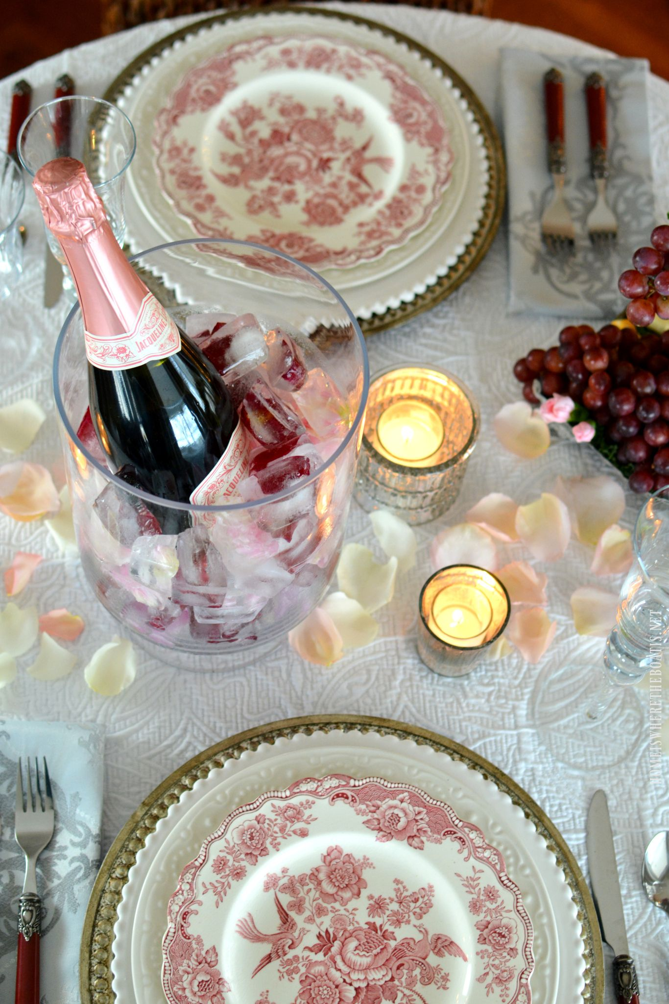 Romantic Table for Two for Valentineu0027s Day with rose petals and floral ice cubes for ch&agne & Romantic Table for Two for Valentineu0027s Day with rose petals and ...