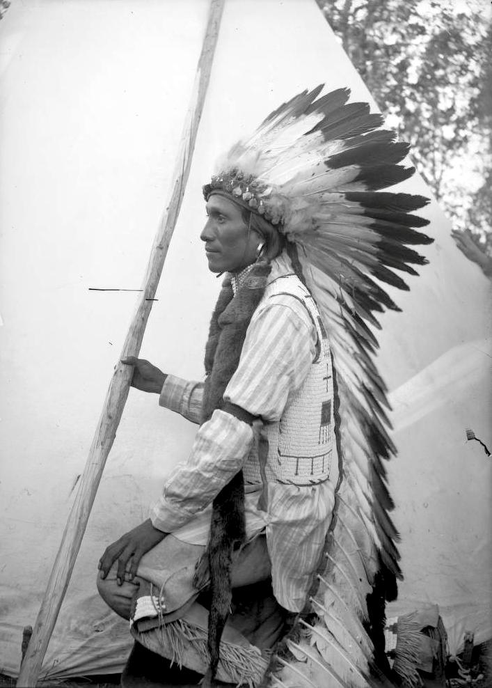 An Arapaho man. 1880-1900.