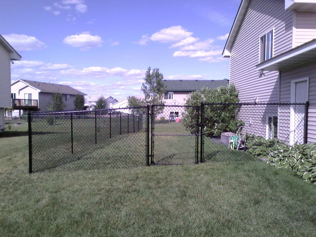 For my back yard a 4 black vinyl chain link fence seems