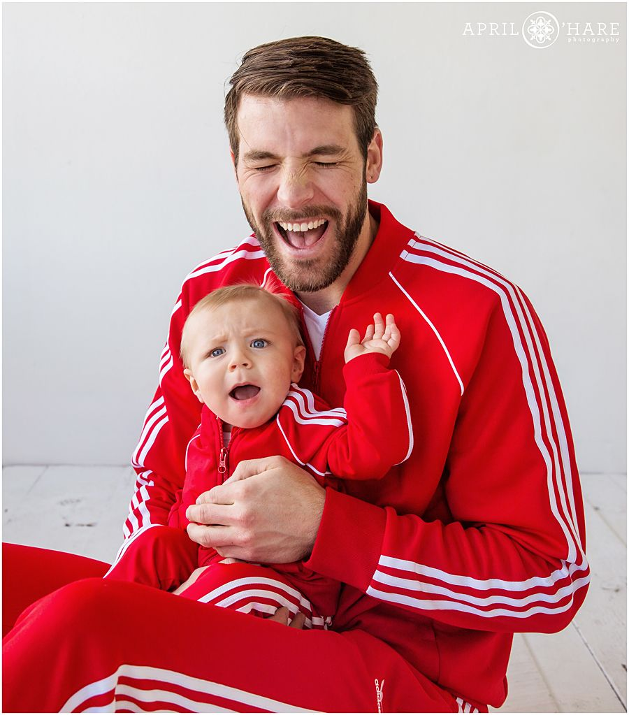fb38a9435 Cute daddy and baby son wearing matching red adidas tracksuits for their  natural light family portraits at the west Colfax Denver Photo Collective  in ...