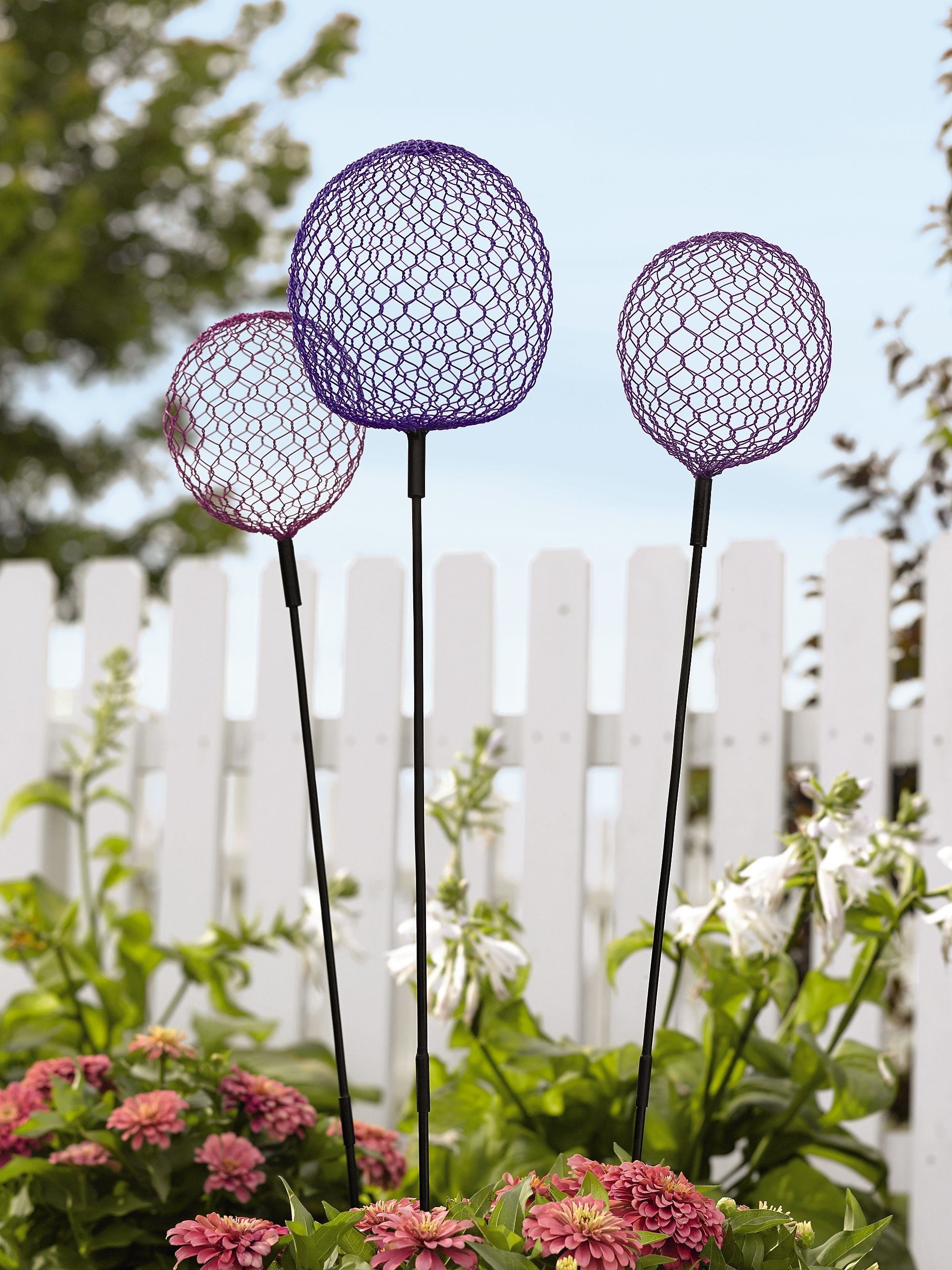 Globe Allium Stakes Set of 3, need no watering.  Alliums are the large, usually lavender globe onions that look so great on sturdy stems.  Here's the easy care version for indoors and out, from Gardeners Supply, $40