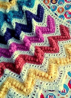 Chevron Bobble and Eyelet Crochet Stitch Baby Afghan in Brights with White between and edge