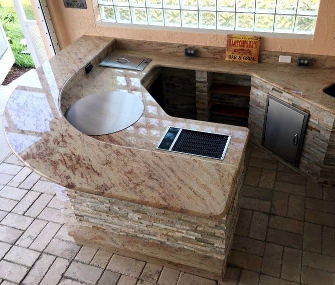 An outdoor kitchen in Naples with our Cook-N-Dine round built-in ...