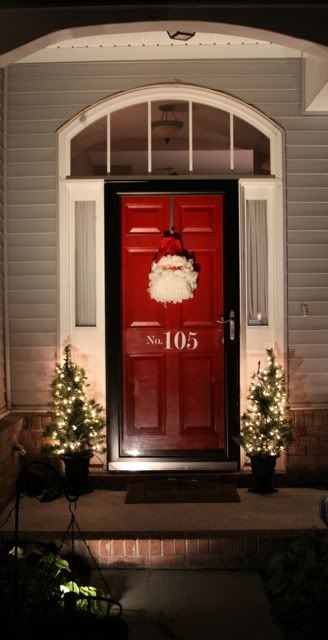 Black Framed Storm Door And Bright Front Door (with The House Number  Painted On The Door)