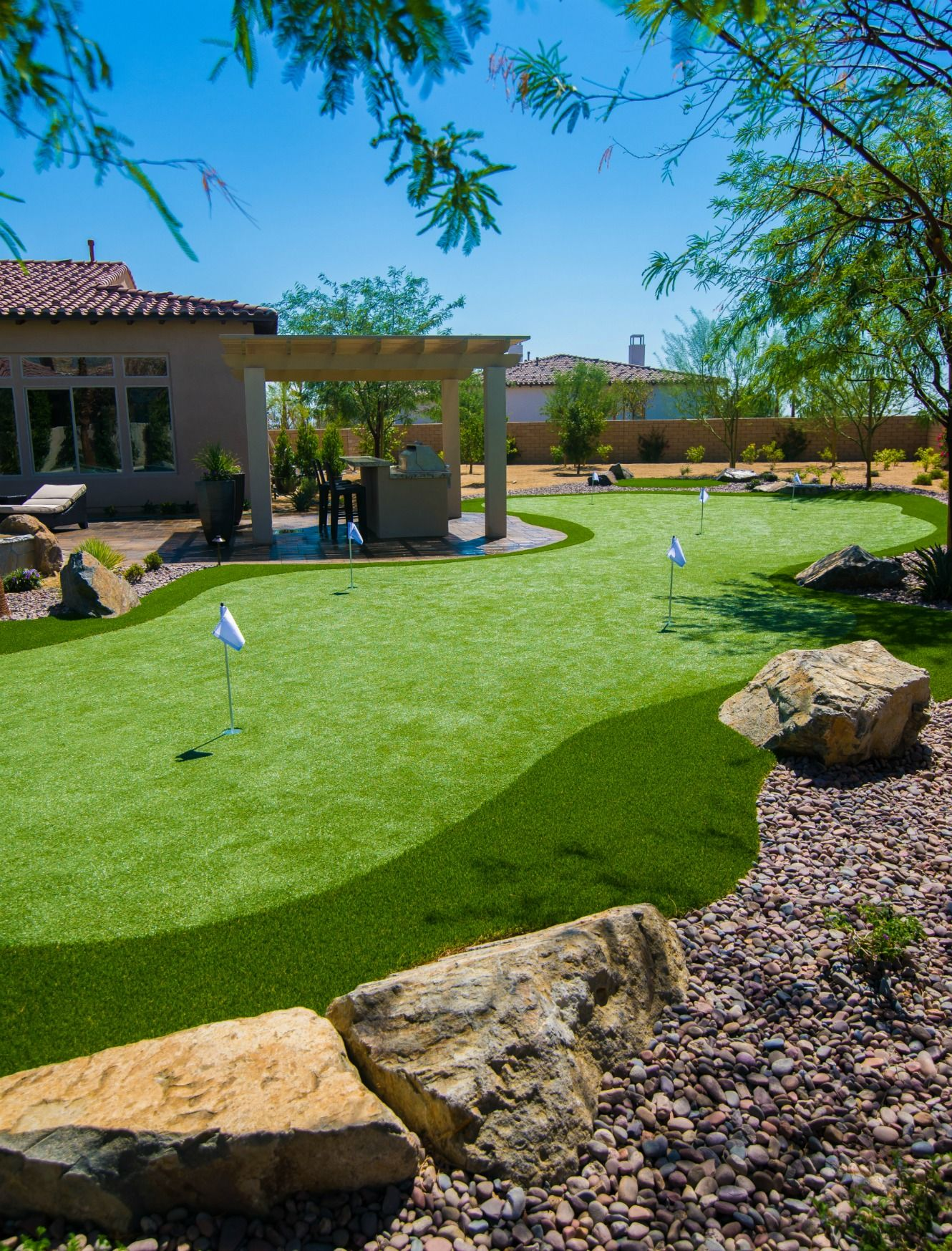 These lucky homeowners can now play #golf anytime of the ... on Putting Green Ideas For Backyard id=14680
