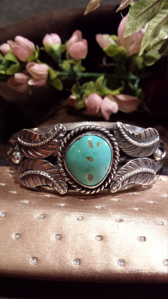 Native American turquoise sterling silver cuff. This piece is in excellent condition and weighs 52.5 grams. The cuff measures 6 1/2 on the