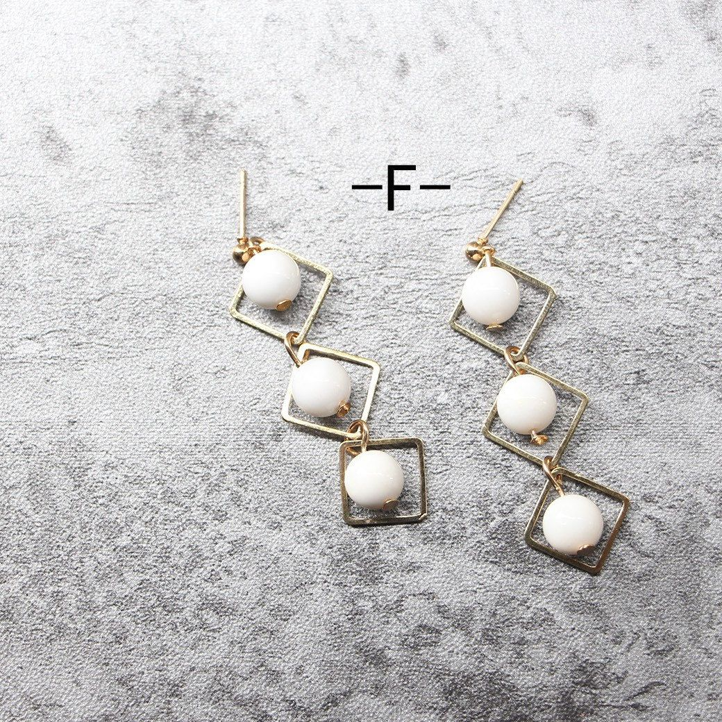 White series earrings by hand