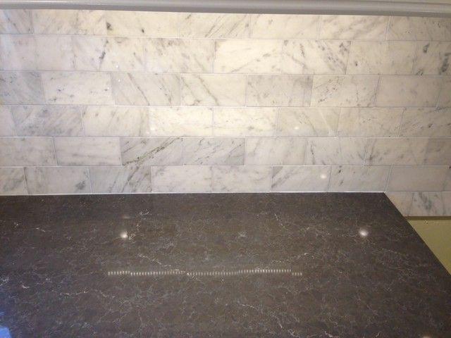 Piatra gray quartz countertop with carrara marble for Carrara marble slab remnants