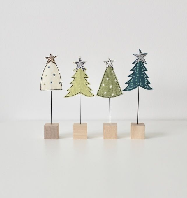 A Christmas Tree with a Wire Stem and Wooden Block Stand