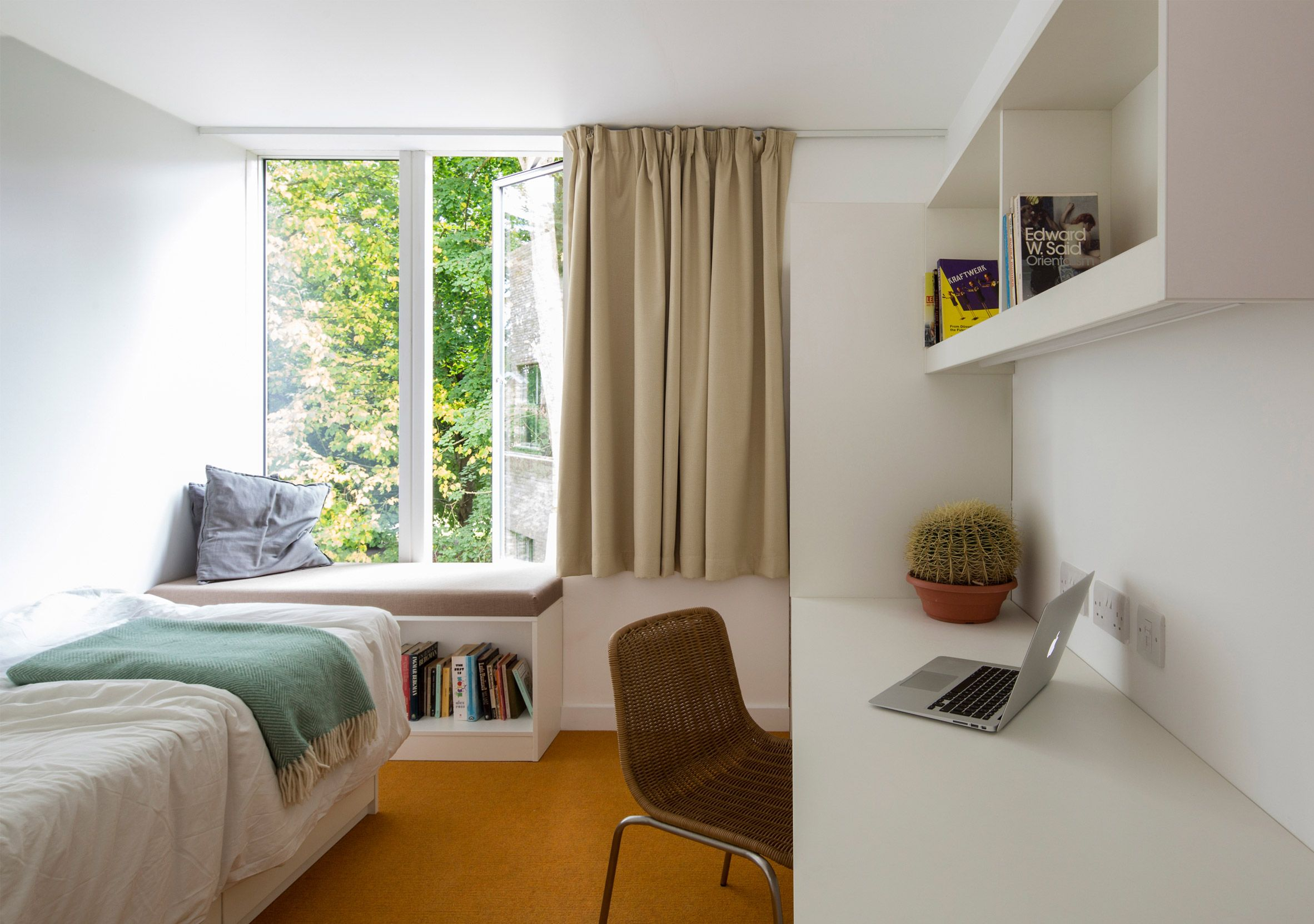 Bed against the window  the ensuite bedrooms feature coloured flooring that stands out