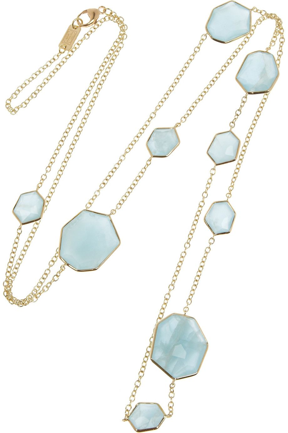 Layer it with similar designs against a simple white top to perfectly showcase the oceanic hues.