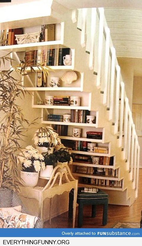 creative way to use bottom of staircase under shelves books rh pinterest com