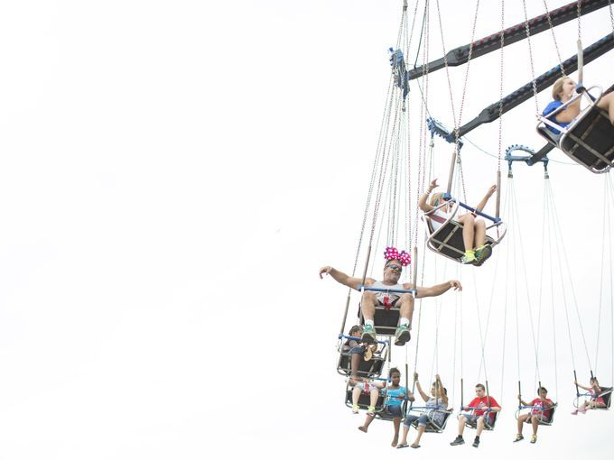 (center) Tommy Wise of Marion County, KY joins others for a swing at the Kentucky State Fair.  The fair runs from now until August 24th at t...