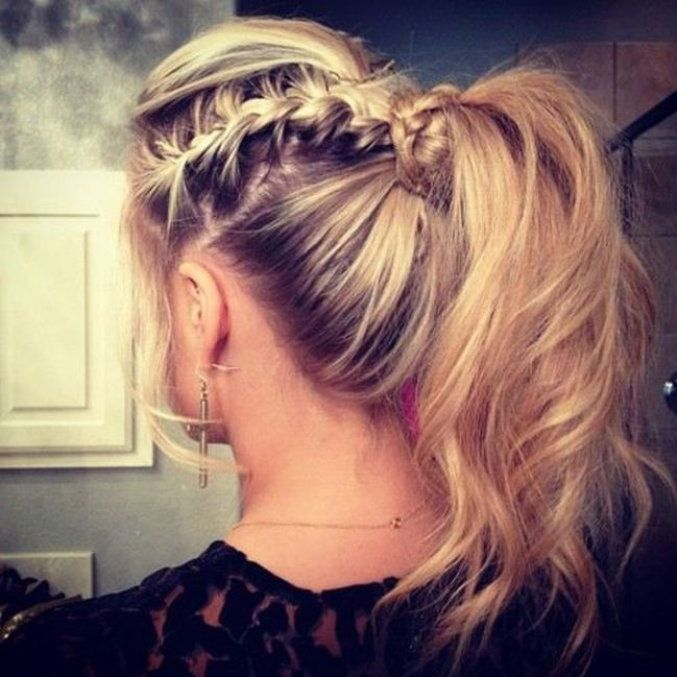 messy curled ponytail with french braid and messy mohawk.