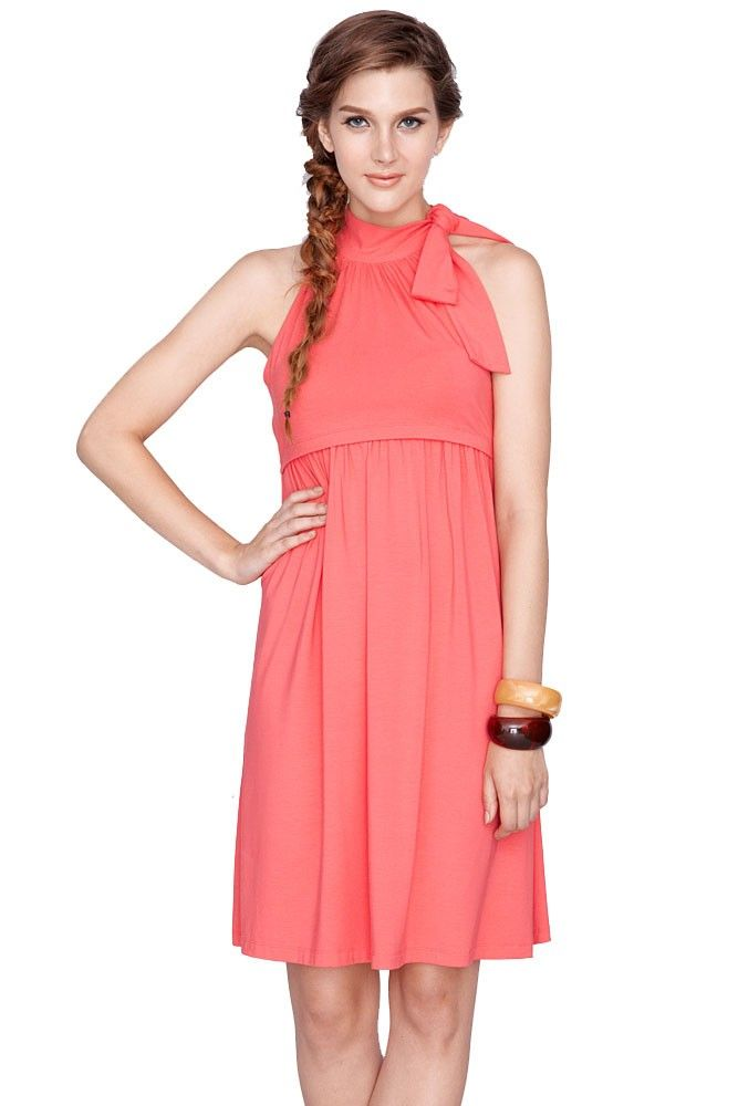 bc9869b5f0645 This halter dress style features a fun bow tie at neck. Empire nursing  access makes this dress functional and full of style!