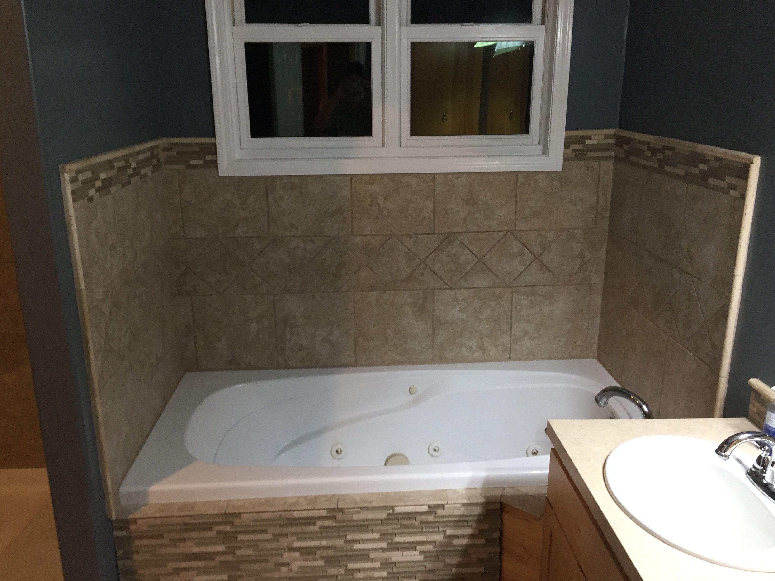 Tiled Tub Surround With A Glass Access Panel For This Foot Jetted - Bathroom remodeling contractors minneapolis