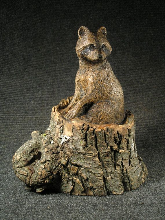 Raccoon in stump hand carved wood sculpture just stuff