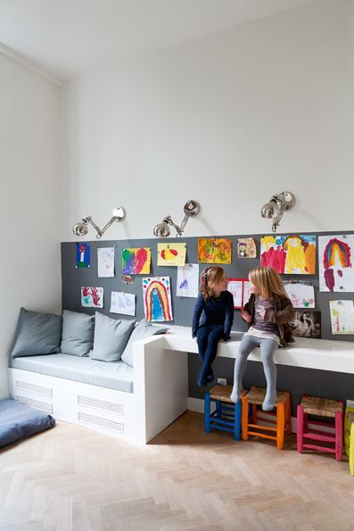 Vaste bank. Add shelf above pinboard. Those little stools remind me of my childhood!