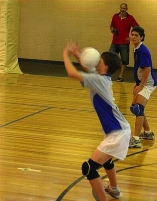 This is how I play volleyball. This photo is also funny, because the boys are playing volleyball in very short shorts.