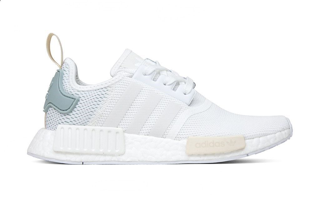 1a3540df7 These womens NMD R1 features a textured mesh upper for a sleek knit look  with suede lining