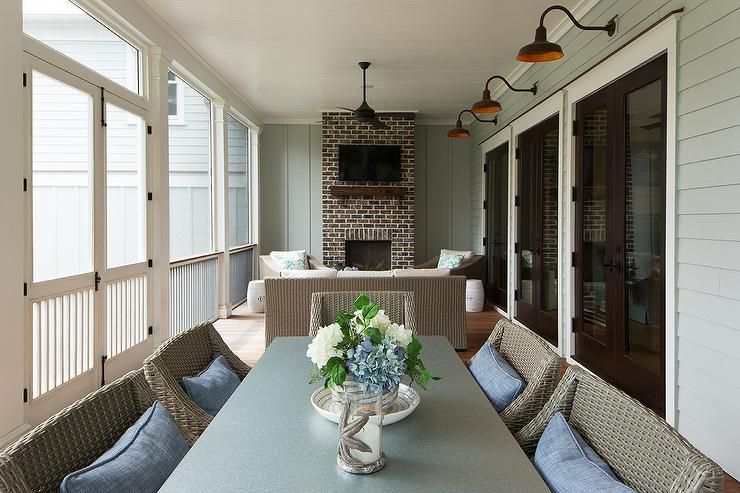 Enclosed back porch in a cottage home featuring a brick ... on Enclosed Back Deck Ideas id=91616