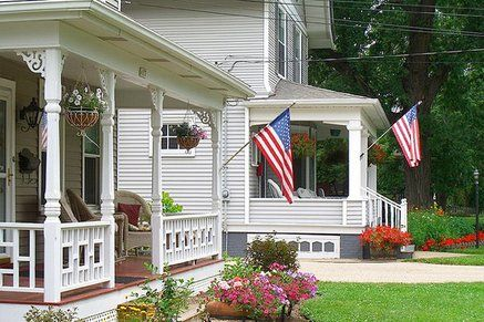 Houses Displaying The American Flag On Their Porches No
