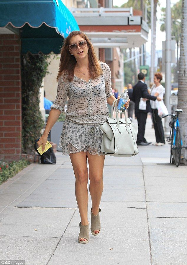Total babe: She teamed her revealing top with an equally daring mini skirt  which was
