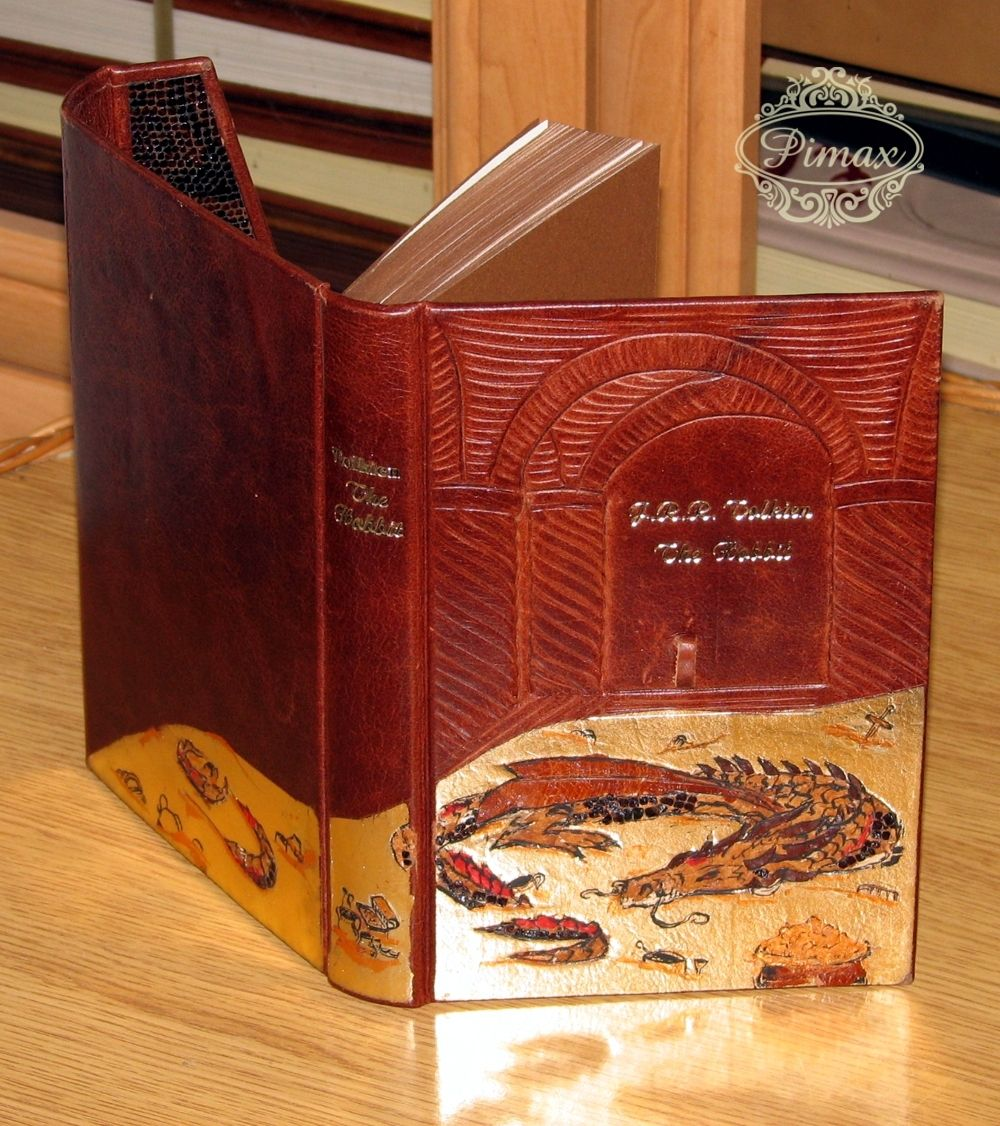 An edition of The Hobbit published by HarperCollins in 2007 hand bound by binders at Pimax in Poland. Thid binding received a bas-relief onlay enhanced with hand made tooling of Smaug the dragon. The book can be closed like a folder.