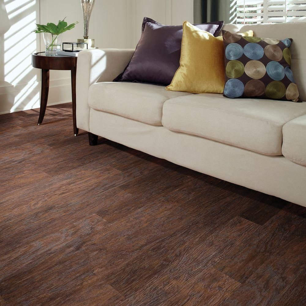 This Hand Scraped Dark Hickory Laminate Flooring Has An