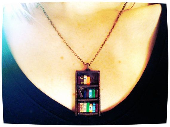 Bookshelf necklaces by Coryographies - made of wood and clay, 1.5 inches tall! She does commissions...