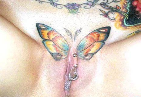 Buterfly tattooed pierced pussy #15