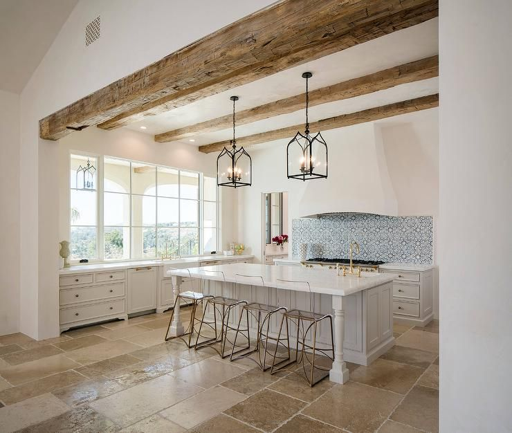 Mediterranean Kitchen Features A White Stucco Vent Hood Which Stands Over And Blue Mosaic Tiled Backsplash Stainless Steel Stove