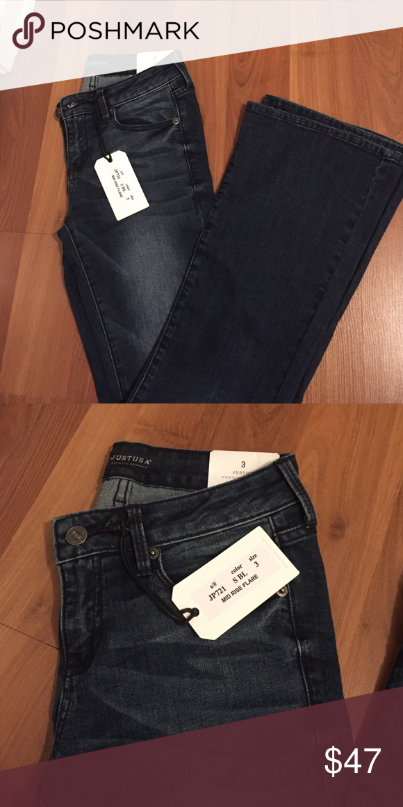 Bell bottom/flare dark colored jeans From Entourage boutique, great jeans just have two pairs. NEVER WORN. Tags attached!! Size 3 (flare/bell bottom) Entourage boutique Jeans Flare & Wide Leg