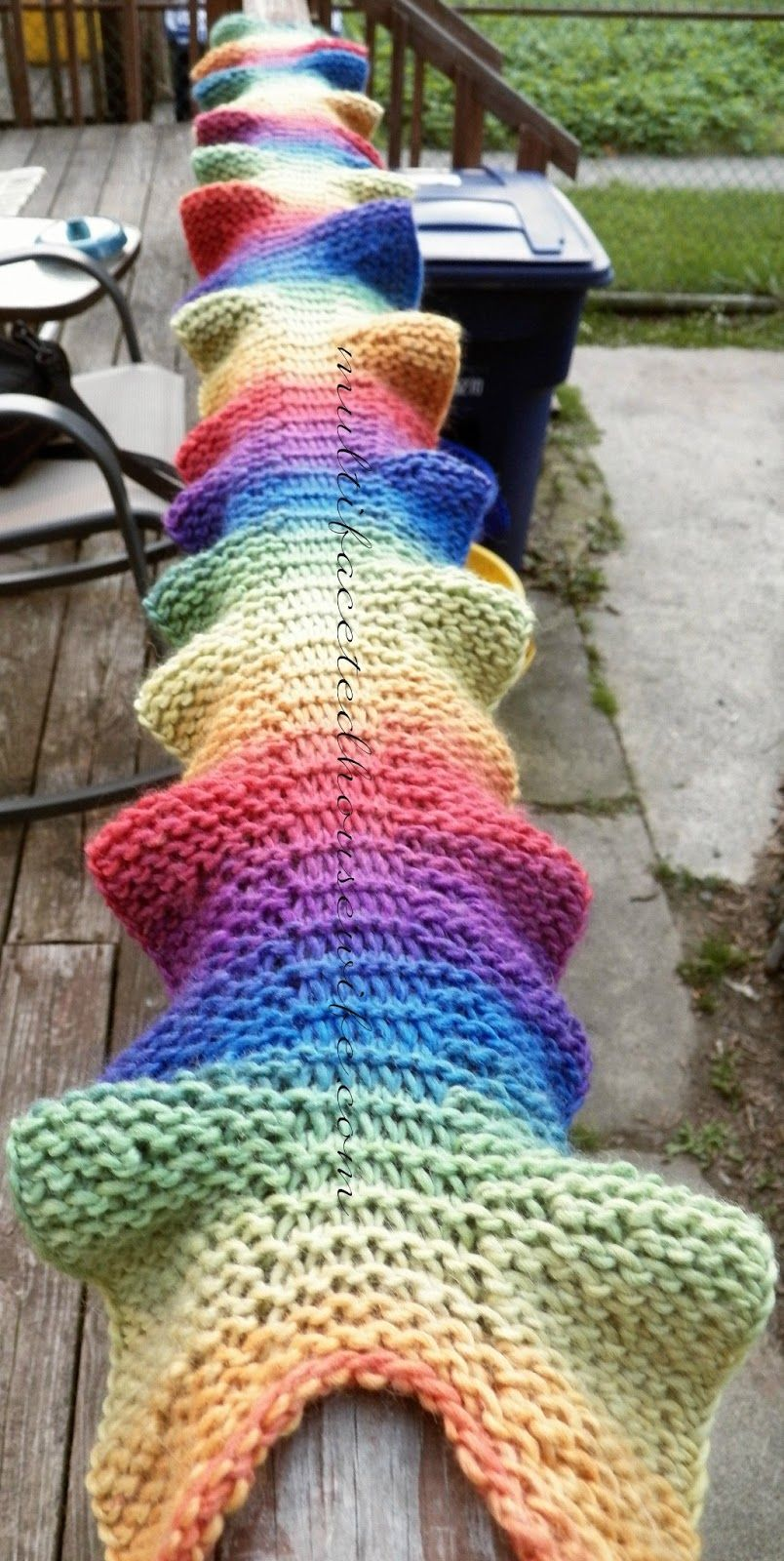 Loom Knit Rainbow Sea Dragon Scarf -- would work up quickly for a yarn bombin...