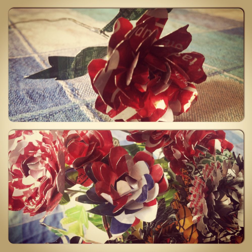 These are the goooorgeous tin-can flowers that my friend's daughter showed me.  Here comes my Tim Holtz tattered floral and the 100's of tin cans we have in recycling!