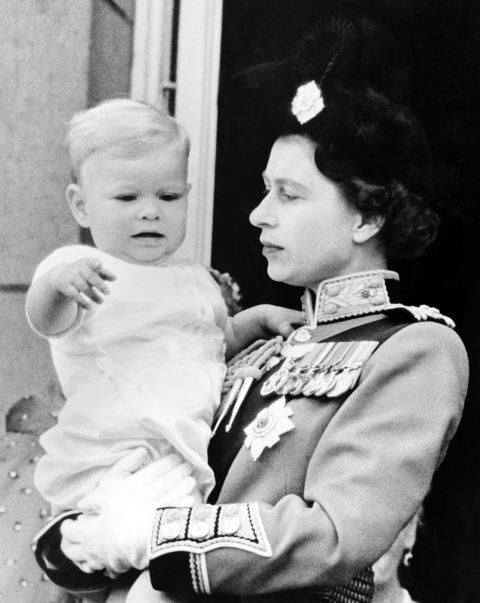 Prince Andrew with his mother, Queen Elizabeth II, in 1961. See the full history of royal babies and their chubby cheeks.