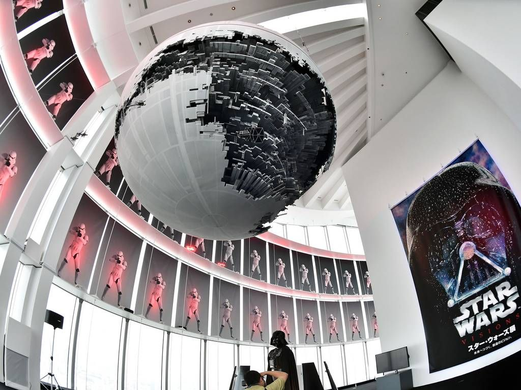 "A statue of Darth Vader and a model of the Death Star are displayed at the preview of the ""Star Wars Vision' exhibition in Tokyo. Star Wars-related objects will be exhibited at the exhibition from April 29 through June 28, while the new Star Wars movie will be screening end of this year"