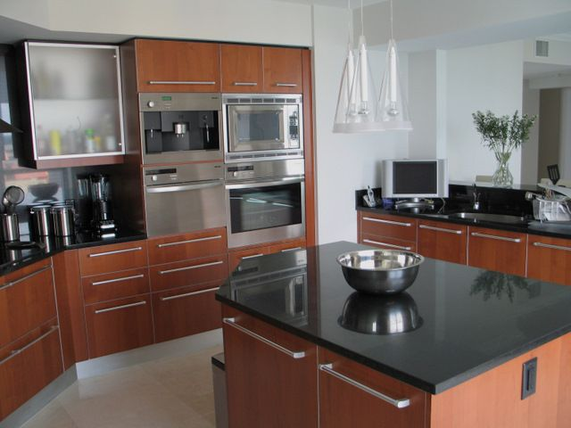 Elegant cherry cabinets with easy-grab silver handles ...