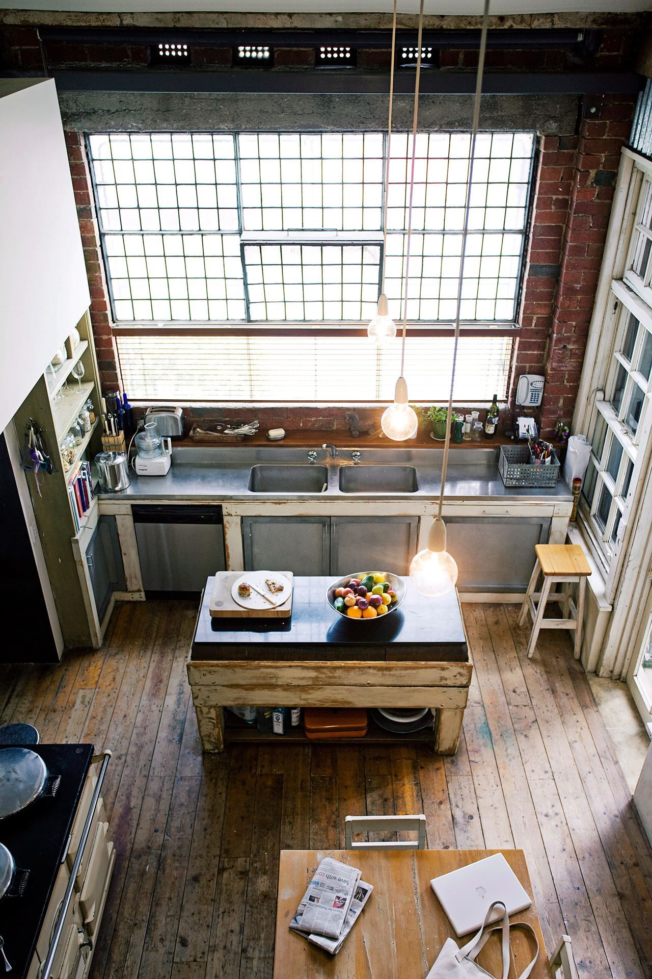 Nyc is known for its loft apartments converted from former factories this kitchen combines industrial stainless steel with rustic timber for a truly