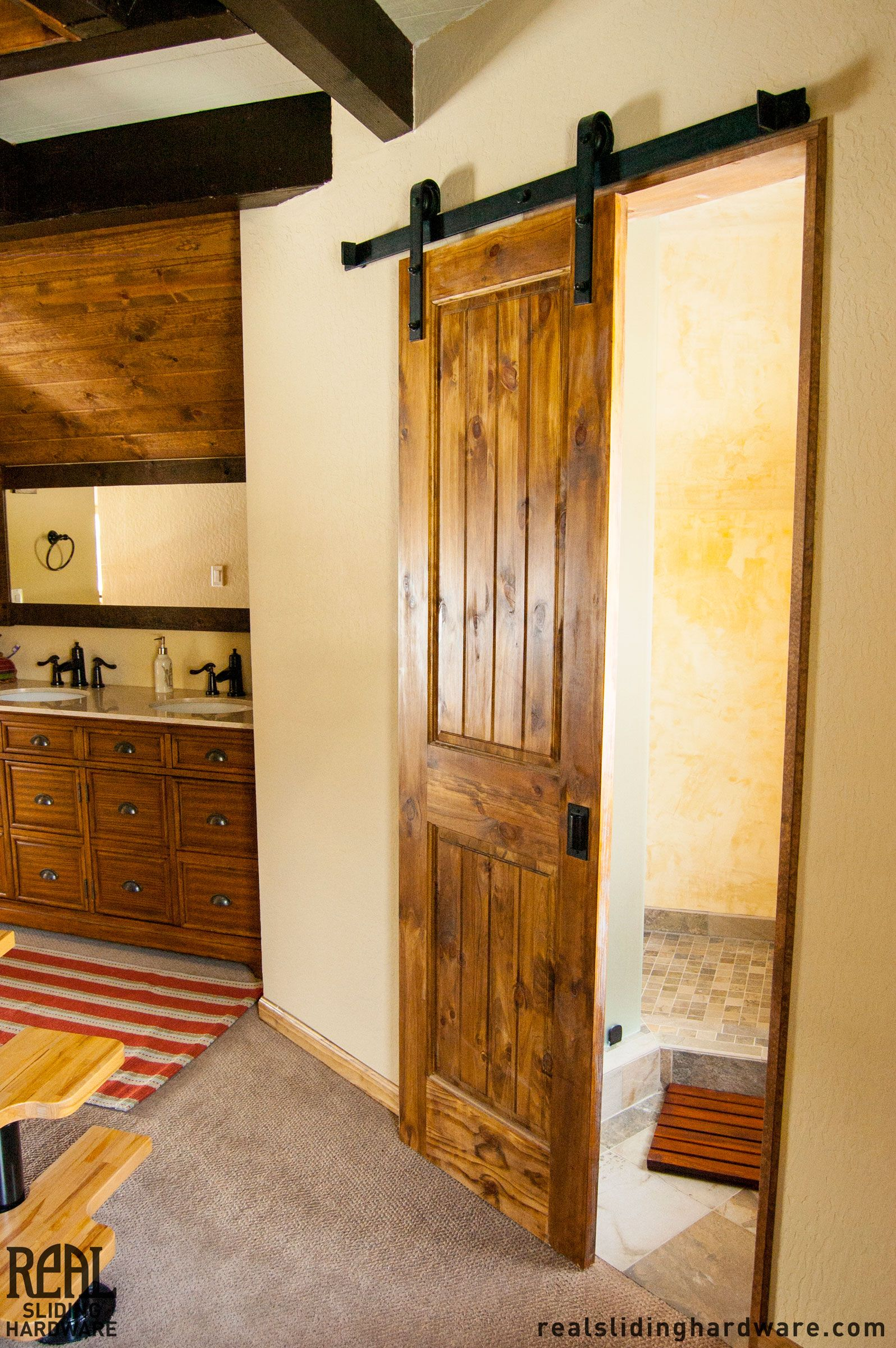 A Teeny Tiny Bathroom Uses Barn Door Hardware To Economize Space
