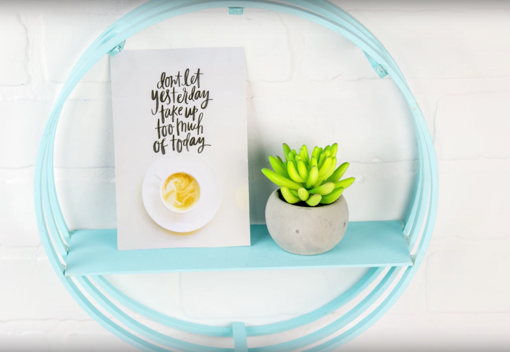 We created this super cool DIY Circle Shelf out of embroidery hoops and you won't believe how great this DIY Project turned out. They make great room decor and everyone will want to know how you made it. If you want to learn how to craft with embroidery hoops, you can watch the video or read the tutorial down below!