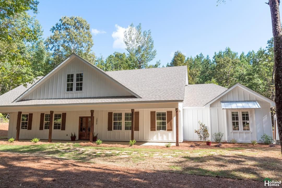 Our Newest Farmhouse Is In The Perfect Location Nestled In A Wooded Lot Hollandhomesllc Buildingreput Modern Farmhouse Plans Farmhouse House House Exterior