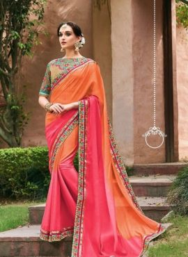 f1012ecd90097 Orange silk saree with heavy embroidered contrast blouse