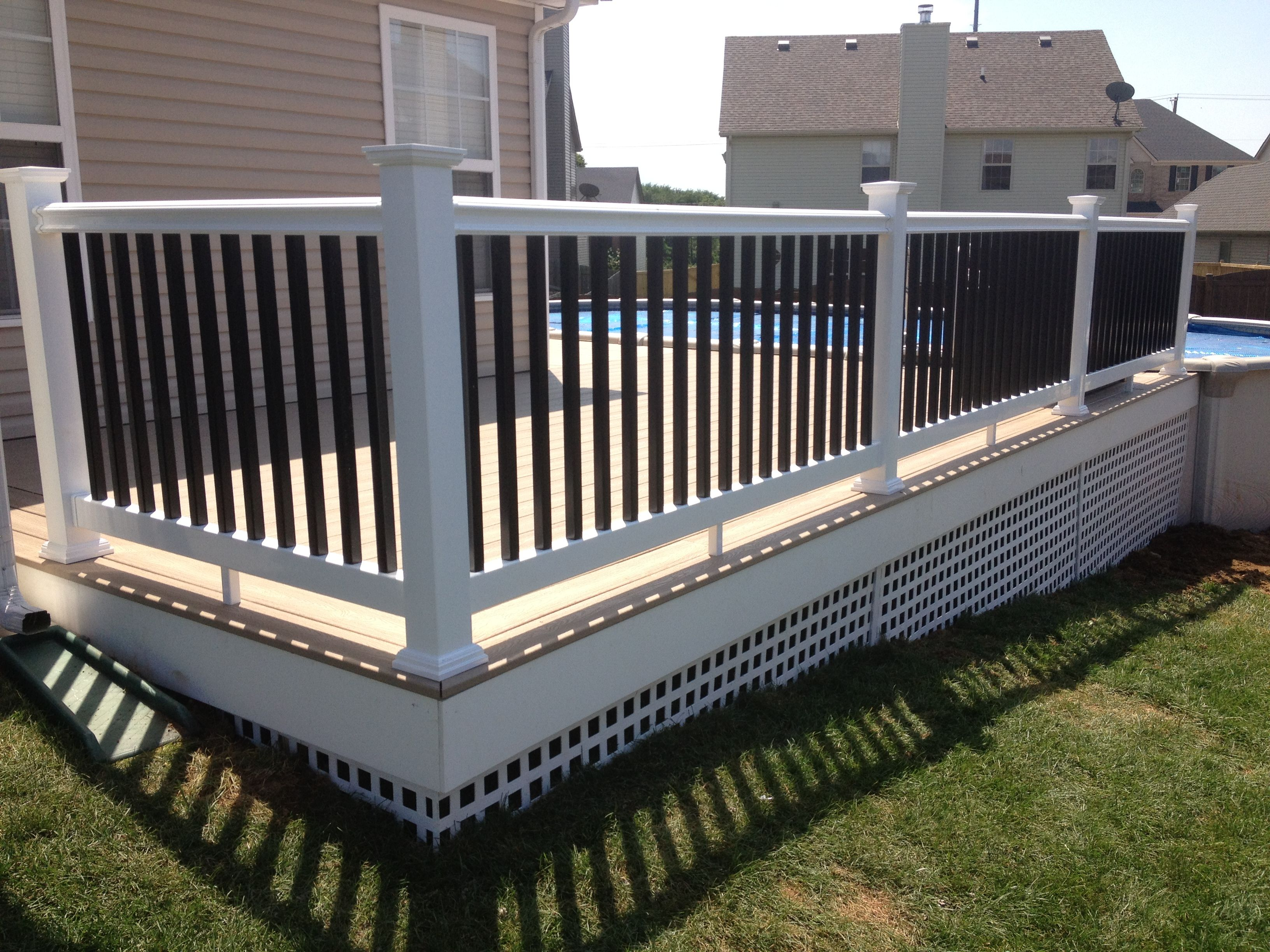 Swimming pool access deck trex transcends rope swing for Composite decking and railing