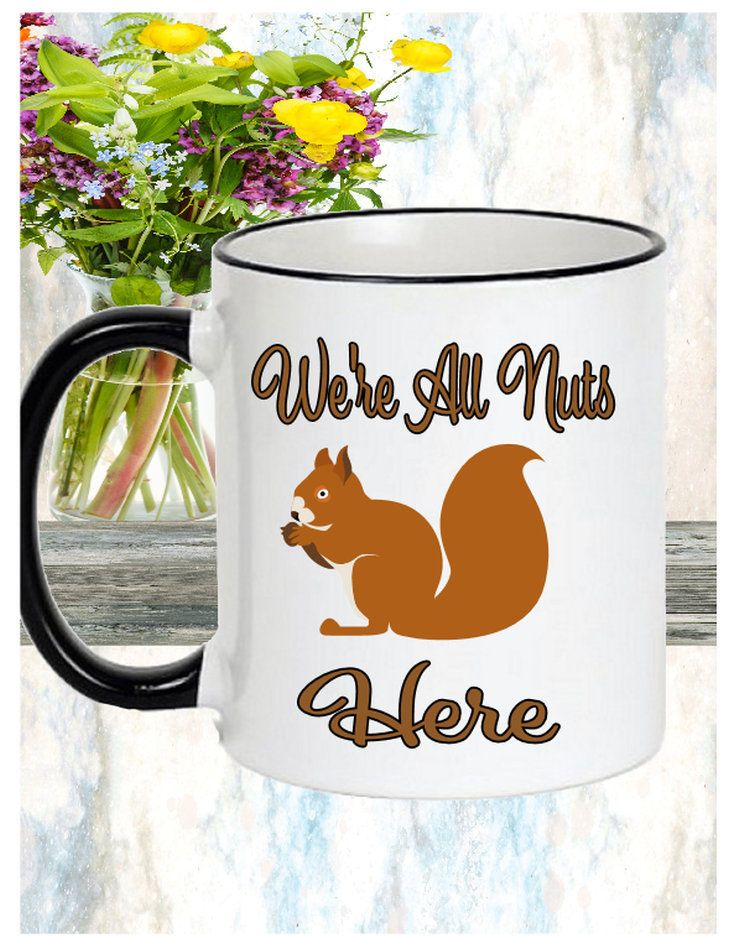 Mug states: We're All Nuts Here 11 oz (330 ml) or 15 oz (450