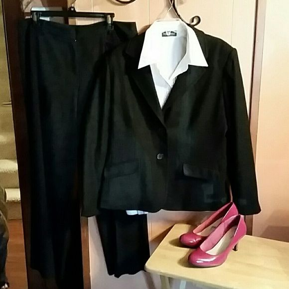 Warm wool blazer. Excellent condition.  Black wool blazer. Double button on front with front pockets. Three buttons on the sleeves. New York & Company Jackets & Coats Blazers