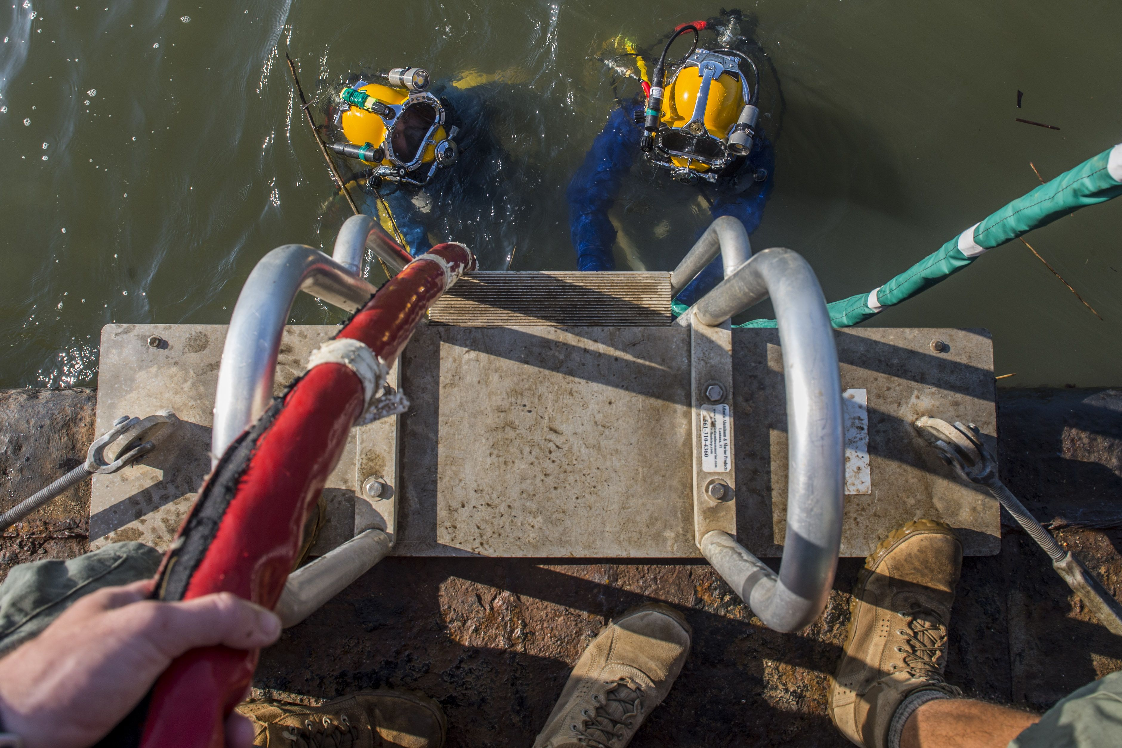 Navy divers assigned to mobile diving and salvage unit 2