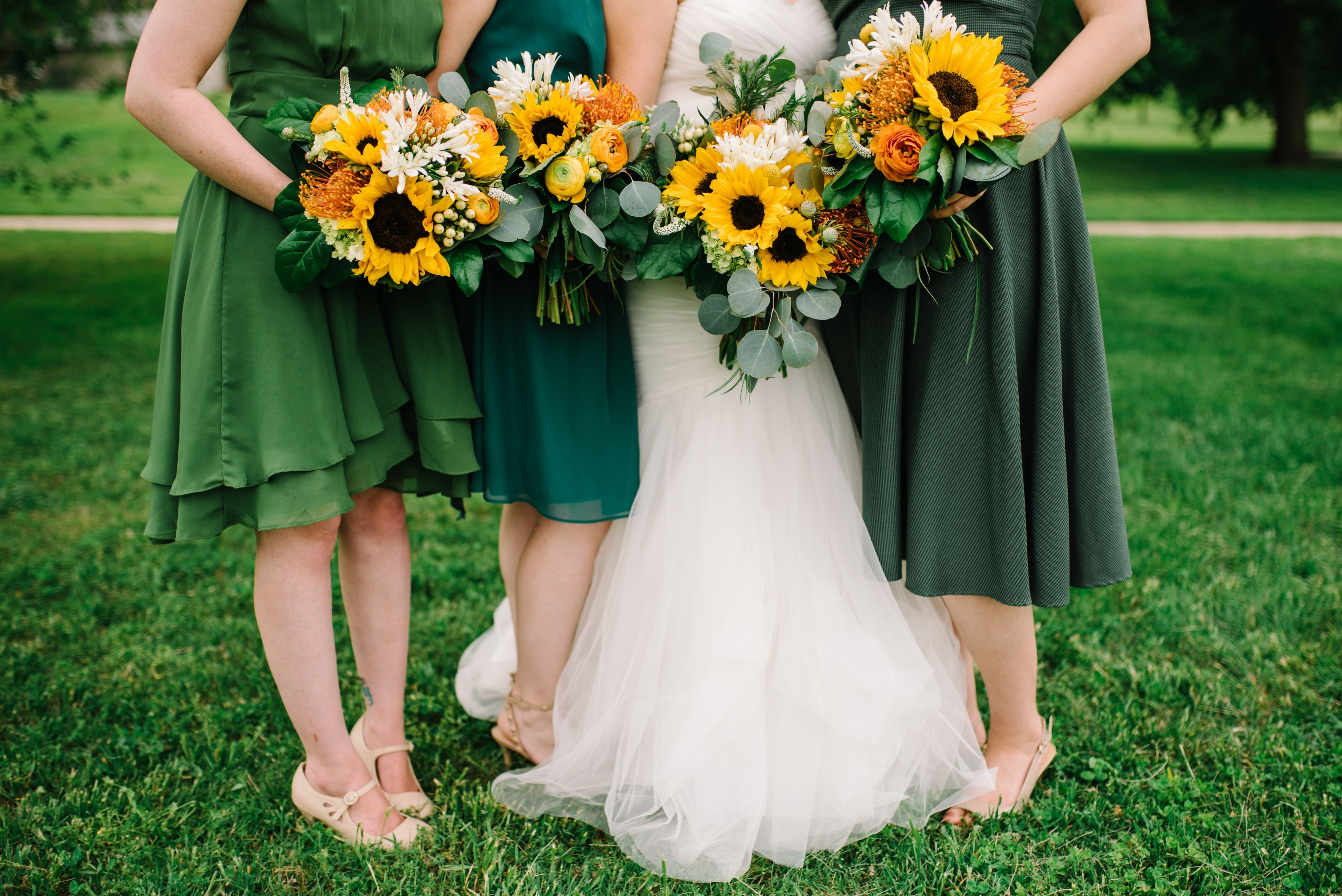 Bridesmaids In Green With Sunflower Bouquets Lilac Wedding