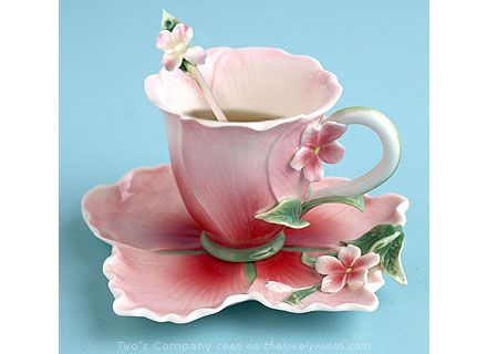 Lovely Pink and White Teacup and Saucer. The Saucer is petal shaped- delightful